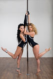 Beautiful dancer dancing with a pole stock photo