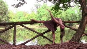 Beautiful dancer doing workout outdoors stock video footage