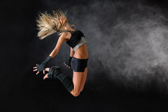 Beautiful dancer exercise jump in studio practice. Dancing rehearsal performance Royalty Free Stock Photos