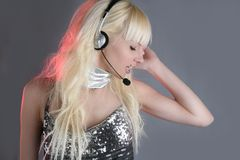 Beautiful dancer fashion sequins headset girl. Beautiful dancer fashion sequins headset blond woman royalty free stock image