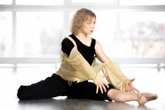 Beautiful dancer female sitting in half-split position Stock Photography