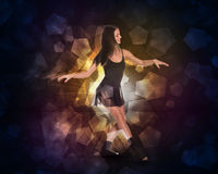 Beautiful dancer. Glow multicolor pentagons Stock Photo