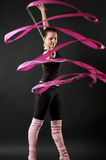 Beautiful dancer with pink ribbon Royalty Free Stock Photo