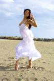 Beautiful dancer posing on the beach Stock Photography