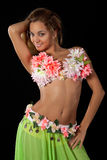Beautiful dancer in tropical costume. Stock Images