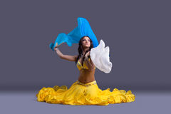 Beautiful dancer in yellow costume sit on floor Royalty Free Stock Image