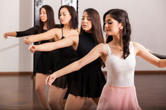 Beautiful dancers training on barre Royalty Free Stock Photo