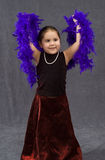Beautiful Dancing. A young girl is dancing while wearing a pearl necklace and a feather boa Stock Photos