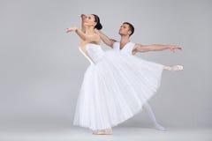 Beautiful dancing couple performing ballet. Stock Photos
