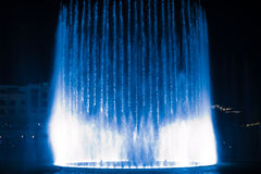 Beautiful dancing fountain illuminated at night Royalty Free Stock Photo