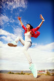Beautiful dancing girl jumping Stock Photos