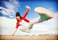 Beautiful dancing girl in movement. Sport, dancing and urban culture concept - beautiful dancing girl in movement Stock Images
