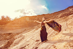 Beautiful dancing girl with oriental make-up and indian sari Stock Photos