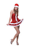 Beautiful dancing girl in santa dress Stock Image