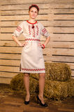 Beautiful dancing girl in ukrainian polish national traditional costume clothes happy smile, full length portrait isolated over wh Stock Image