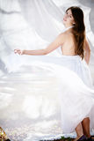 Beautiful dancing girl in white. Dress stock photography