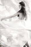 Beautiful dancing girl in white dress Stock Photos