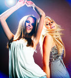 Beautiful dancing girls. Portrait of a beautiful dancing girls on dark background Royalty Free Stock Photos