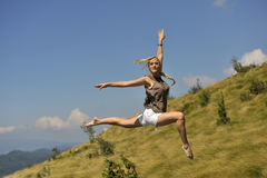 Beautiful dancing with high jump in nature Royalty Free Stock Images