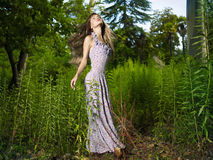 Beautiful dancing lady in the forest Royalty Free Stock Photo