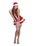 Beautiful dancing woman weared in santa clause dress Royalty Free Stock Images