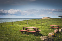 Beautiful Danish countryside view with red benches Stock Image