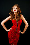 Beautiful, daring red-haired girl in a red dress Royalty Free Stock Photos