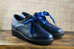 Beautiful dark blue leather female boots. stock photography