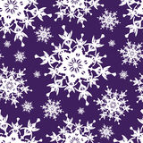 Beautiful dark blue seamless pattern with snowflakes Royalty Free Stock Photos