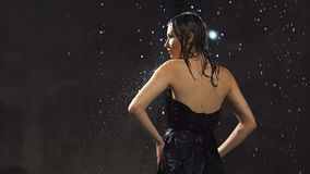 Posing under the Rain stock video footage