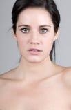 Beautiful Dark Haired Girl against Grey Stock Image