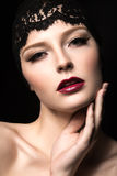 Beautiful dark-haired girl with long eyelashes, red lips and lace on her head. Beauty face. Stock Images