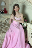 Beautiful dark-haired girl in the pink evening dress Stock Image