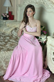 Beautiful dark-haired girl in the pink evening dress Royalty Free Stock Photography