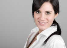 Beautiful Dark Haired Girl Smiling into the Camera Royalty Free Stock Photography