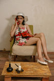 A beautiful dark-haired girl is talking by phone Royalty Free Stock Images