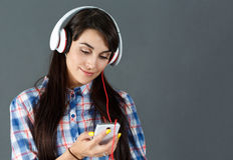 Beautiful dark haired smiling woman wearing headphones Stock Image