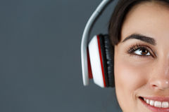 Beautiful dark haired smiling woman wearing headphones Royalty Free Stock Photo