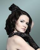 Beautiful dark-haired woman. Fashion portrait of a young beautiful dark-haired woman Royalty Free Stock Photo