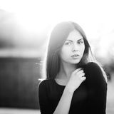 Beautiful dark-haired woman in black and white Royalty Free Stock Images