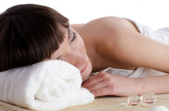 Beautiful dark-haired woman lying in the spa Stock Images