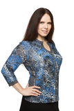Beautiful dark-haired woman in a office blouse. Beautiful dark-haired woman in a blouse royalty free stock images