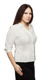 Beautiful dark-haired woman in a office blouse Stock Image