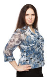 Beautiful dark-haired woman in a office blouse. Beautiful dark-haired woman in a blouse royalty free stock photo