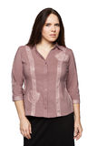 Beautiful dark-haired woman in a office blouse. Beautiful dark-haired woman in a blouse royalty free stock image