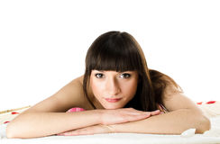 Beautiful dark-haired woman relaxes Royalty Free Stock Photos