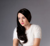 Beautiful dark haired woman in white sweater Royalty Free Stock Photos