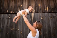 Mother holding little baby stock photos