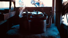 Beautiful dark metallic tea kettles of a tea shop in Bangladesh. Tea kettles with boil smoke in a traditional tea shop in Bangladesh creative photo royalty free stock photo