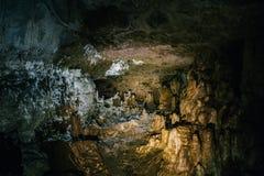 Beautiful dark natural underground cave. With Stalactites and stalagmites Stock Photos